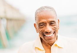 Happy senior African American man outside smiling